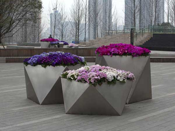 What are the features of large outdoor planters?